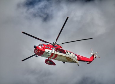 File photos of a Coast Guard helicopter