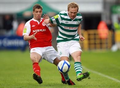 Darren Meenan of Pat's with Conor McCormack of Rovers.