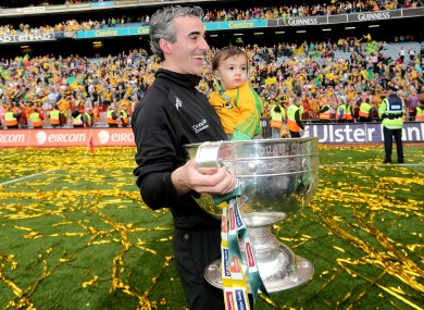 McGuinness with his son Jim Jr and Sam Maguire.