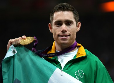 Ireland's Jason Smyth celebrates with his Gold medal on the podium after winning the Men's 200m T13 Final at the Olympic Stadium