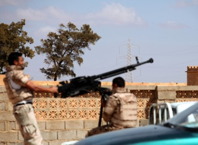 Soldiers from the Libyan National Army get ready to enter Rafallah al-sahati Islamic Militia Brigades compound in Benghazi.