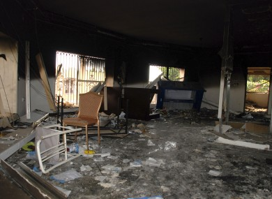 Glass, debris and overturned furniture are strewn inside a room in the gutted US consulate in Benghazi