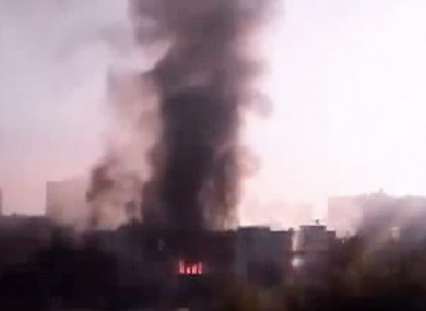 Black smoke rises from Syria's army command headquarters in Damascus, Syria