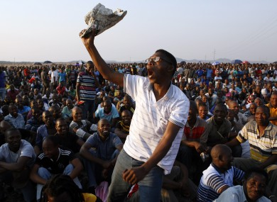 A mine worker sings and dances during a gathering at the Lonmin Platinum Mine near Rustenburg earlier this week.