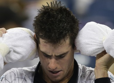 Late night? John Isner ices his head during his defeat to Philipp Kohlschreiber early on Monday morning.