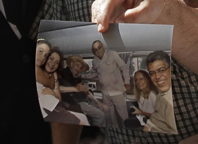 Former Venezuelan Vice President Elias Jaua shows a picture of Cuba's leader Fidel Castro, third from left, at the Hotel Nacional in Havana Sunday October 21, 2012