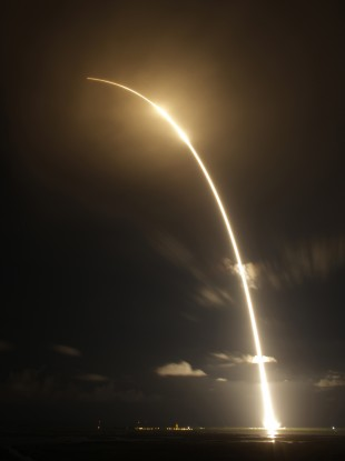 A long-exposure photo shows the Falcon 9 SpaceX rocket lifting off the Cape Canaveral Air Force Station in Cape Canaveral, Florida