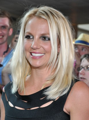 Britney Spears will not appear at her mother's libel trial.