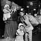 An Italian woman and her children arrive at Ellis Island, New York, in 1905. (Bettmann/CORBIS)