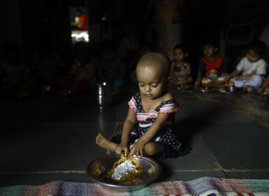 Malnourished Indian children (no names available) eat a meal at the Apanalaya center, an organization working for the betterment of slum children, in Mumbai, India, Tuesday, Oct. 9, 2012.
