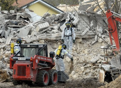 Italian firefighters work on a collapsed stable to remove dead animals from a collapsed stable in L'Aquila, where an earthquake in 2009 killed 309 people.