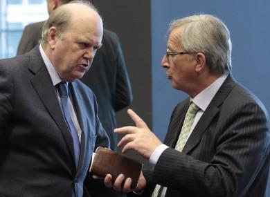 Michael Noonan speaks to Eurogroup president Jean-Claude Juncker before