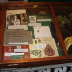 Various pieces of memorabilia including a Royal Irish Constabulary Guide and helmet plate.