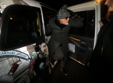 Former pop star Gary Glitter, whose real name is Paul Gadd, returns to his house in central London after his arrest earlier today by police investigating the Jimmy Savile scandal.