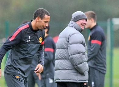 Ferdinand and manager ALex Ferguson at training today.