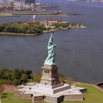 The Statue of Liberty with Ellis Island in the background. (AP Photo)
