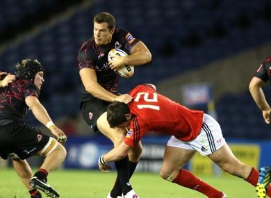 Edinburgh's Tim Visser tackled by James Downey of Munster.