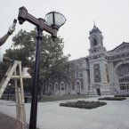 The final touches are applied outside the entrance to the Great Hall on Ellis Island before it was reopened - renovated - to the public on 7 September, 1990. (AP Photo/David Cantor)