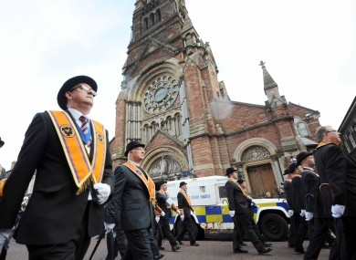 The parade passing St Patrick's Church on Donegall Street.