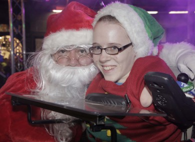 Santa with Joanne O'Riordan, who switched on the lights in Cork
