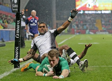 Craig Gilroy dives over for Ireland's first try.