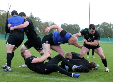 Keith Earls with Paul O'Connell and Cian Healy at training in Carton House yesterday.