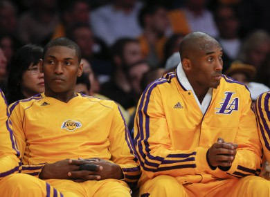 Los Angeles Lakers' Kobe Bryant, right, and Metta World Peace on the bench.