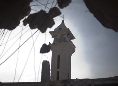 A minaret is seen though the damage of a destroyed mosque in town of Taftanaz, on the outskirts of Idlib, Syria, on Friday.