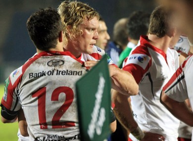 Ulster's Mike McComish and Paddy Wallace celebrate at the end of Ulster's win in Glasgow.