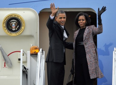 President Barack Obama and first lady Michelle Obama board Air Force One yesterday after Tuesday's election victory.