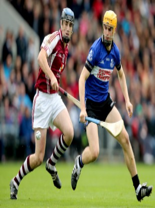Sarsfields Eanna Martin (right) in action in the Cork county final.