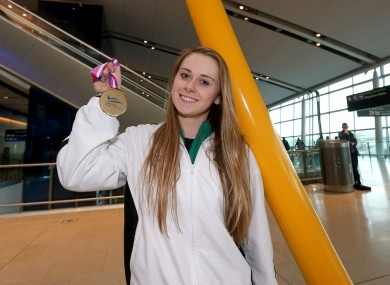 Sycerika McMahon shows off her bronze medal at Dublin Airport.