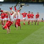 Acrobatics show. Cork's Breige Corkery, Roisin O'Sullivan and Grace Kearney celebrate in style after beating Kerry in Croke Park. (INPHO/Morgan Treacy).