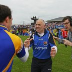 Longford manager Glenn Ryan celebrates a notable Leinster championship victory as Newstalk's sideline reporter Ciaran Murphy waits to interview him. (INPHO/Cathal Noonan).