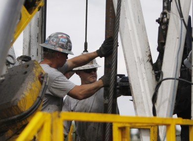 File photo of workers in the US working on a drilling platform that uses the process of fracking.