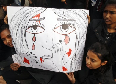 Indian students hold a placard as they participate in a protest rally in Allahabad, India yesterday