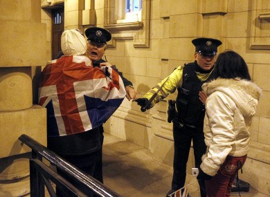 Loyalists clash with PSNI officers after the council voted on the motion on the British flag