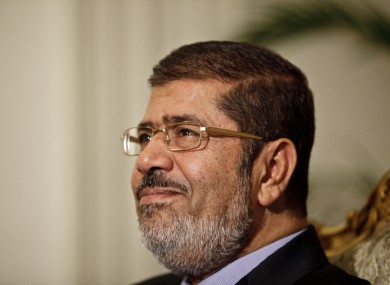 Egyptian President Mohammed Morsi is seen during a photo opportunity in his office at the presidential palace in Cairo yesterday