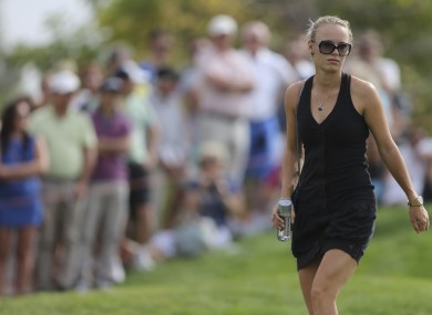 Wozniacki follows McIlroy on the golf course recently.
