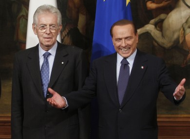 File image of Monti and Berlusconi.