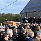Large crowds gather before the funeral of Páidí Ó Sé in Ventry.