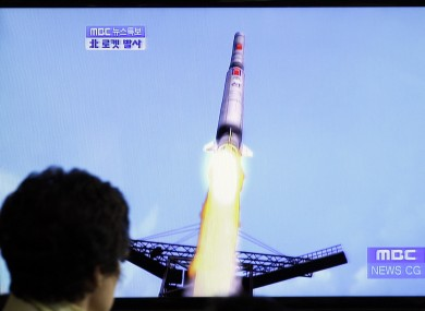 A TV news report shows a computer generated image of North Korea's long-range rocket, which failed after its first launch in April.
