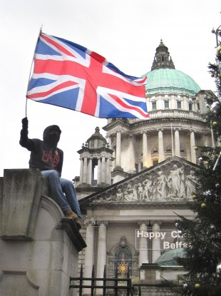 A loyalist protester outside Belfast City Hall on Saturday