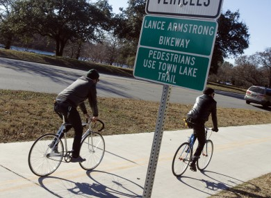 Cyclists rides along the Lance Armstrong Bikeway in Austin, Texas.