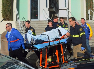 Paramedics transporting a student wounded during a shooting Thursday Jan. 10, 2013 at San Joaquin Valley high school