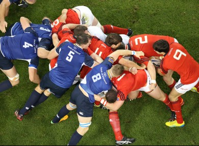 Leinster and Munster contest a scrum at the Aviva Stadium.