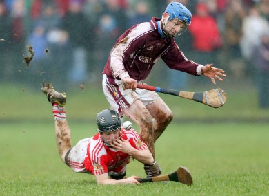 Midleton's Niall Motherway (ground) and