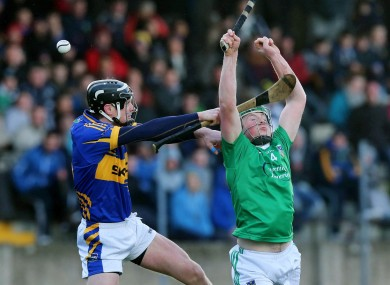 Tipperary's Paul Curran and Shane Dowling of Limerick.