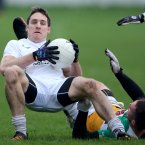 Keeping your footing is difficult. Kildare's Gary White and Offaly's Ross Brady hit the deck here.
