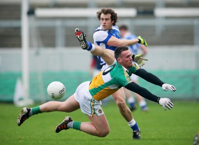 Laois player Padraig McMahon and Offaly's Ross Brady.